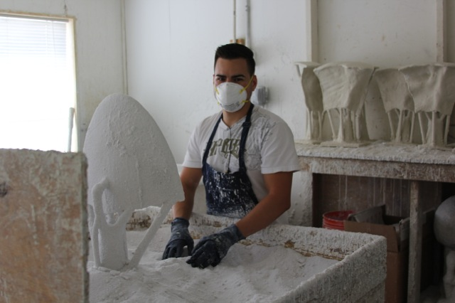 foundry services: dipping the wax in the colloidal silica and sanding with a silica sand